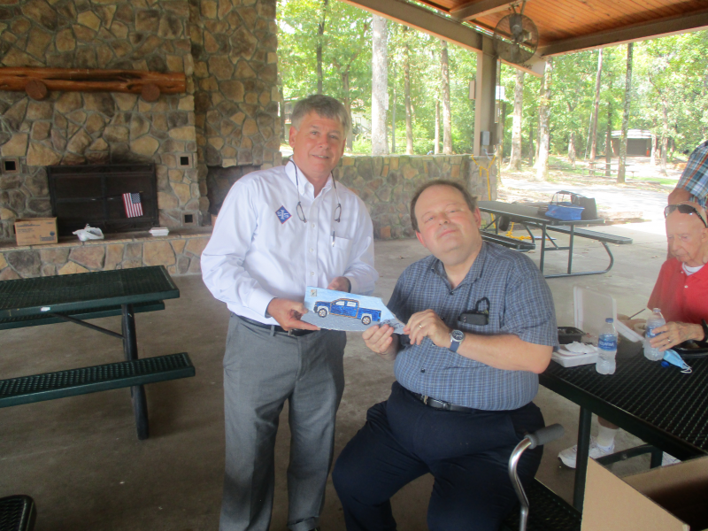 DG Mike Bennage receiving a gift from the Sherwood Rotary Club